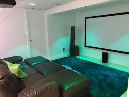 Wellfleet Cape Cod vacation rental - Home theater in basement with leather couch
