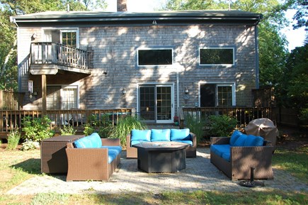 Wellfleet Cape Cod vacation rental - Back patio sitting area; deck has dining table, chaise lounges