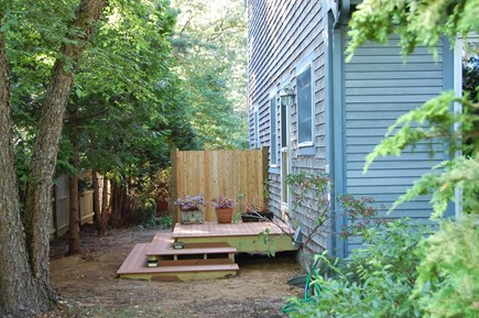 Wellfleet Cape Cod vacation rental - Mahogany kitchen deck, outdoor shower beyond has changing area