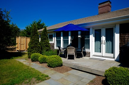 Orleans, MA Cape Cod vacation rental - Back of home with patio seating and access to covered porch