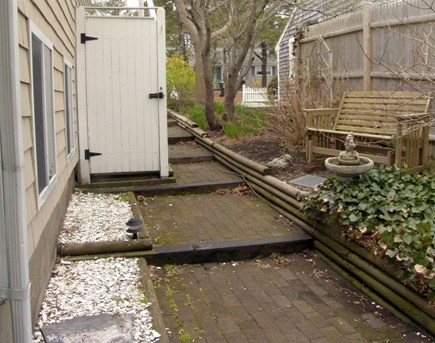 South Yarmouth Cape Cod vacation rental - Outdoor shower and walkway to back yard