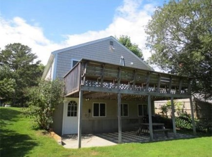 South Yarmouth Cape Cod vacation rental - Deck with slider access from both bedrooms and patio below.