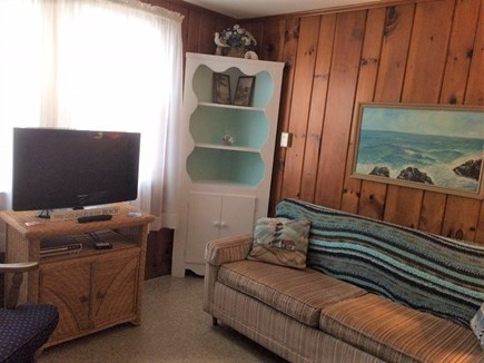 West Dennis Cape Cod vacation rental - Knotty pine cottage living area