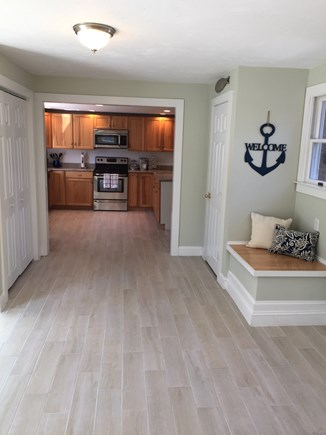 Brewster Cape Cod vacation rental - Breezeway to kitchen with laundry area and storage closet