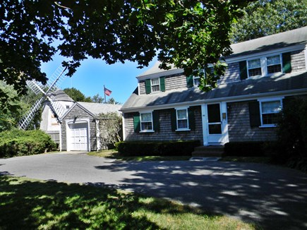 South Yarmouth Cape Cod vacation rental - Street view of front with historic windmill next door