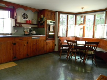 South Yarmouth Cape Cod vacation rental - Kitchen is dated but very functionable. Extra refig. in basement