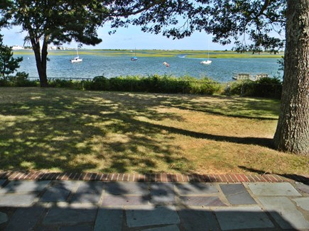South Yarmouth Cape Cod vacation rental - Looking out across the patio from the family room window.
