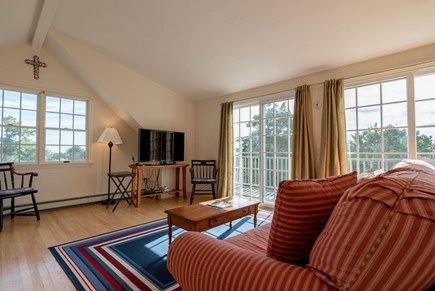 Orleans Cape Cod vacation rental - Sunroom with sliders to small deck, TV and trundle bed