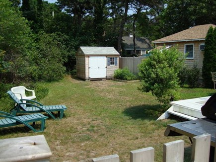 Dennis Port Cape Cod vacation rental - Fenced-in back yard with gas grill and gate that closes