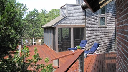 Truro Cape Cod vacation rental - View along expansive deck to screened porch.
