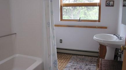 Truro Cape Cod vacation rental - Master bedroom bath with tub/shower