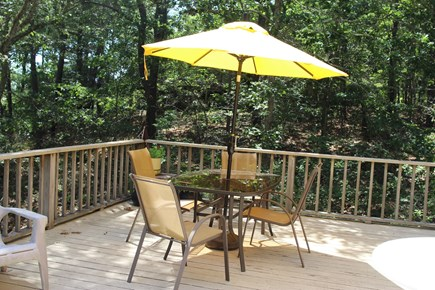 Truro Cape Cod vacation rental - Deck table has an umbrella, nice outdoor dining on a sunny day