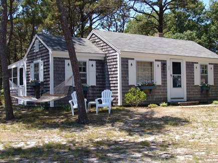 Eastham Cape Cod vacation rental - Front of cottage with a glimpse of the porch in the back