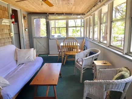 Eastham Cape Cod vacation rental - The screened porch is large and offers space for dining