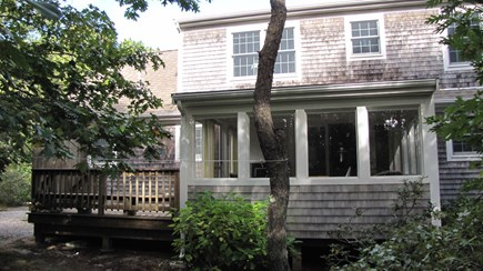 Truro Cape Cod vacation rental - Back of home shows deck and screen porch