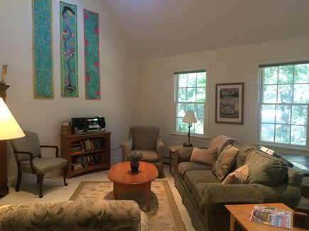 Truro Cape Cod vacation rental - Cathedral ceiling, comfy furnitre and TV in the living room