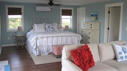 Truro Cape Cod vacation rental - Master Bedroom has king bed, comfy couch looks out to the Bay