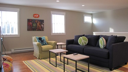Truro Cape Cod vacation rental - Second level family room with large TV, couch opens to queen bed