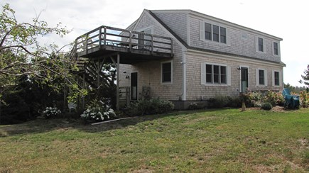 Truro Cape Cod vacation rental - Front of home, large yard and upper level deck