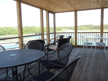 Truro Cape Cod vacation rental - Expansive screen porch has casual furniture and a gas grille