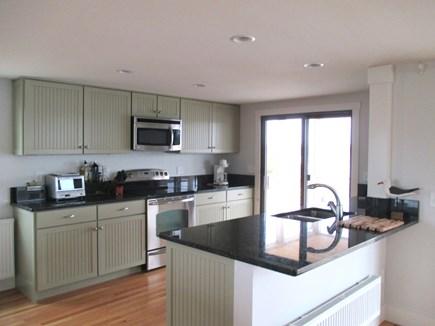 Truro Cape Cod vacation rental - Partial view of kitchen, door to deck