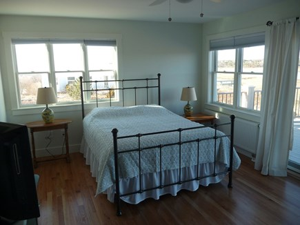 Truro Cape Cod vacation rental - Master bedroom with private bath opens to upper deck