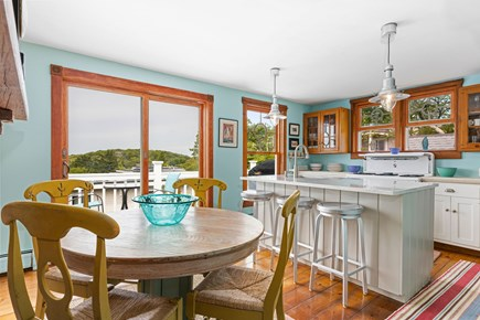 Provincetown Cape Cod vacation rental - Kitchen and breakfast nook with sliders out to the deck