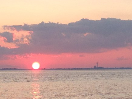 Truro, Beach Point Cape Cod vacation rental - Sun setting over Provincetown - sit on the deck and enjoy!