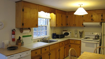 Truro Cape Cod vacation rental - Fully equipped, the kitchen looks over the back yard