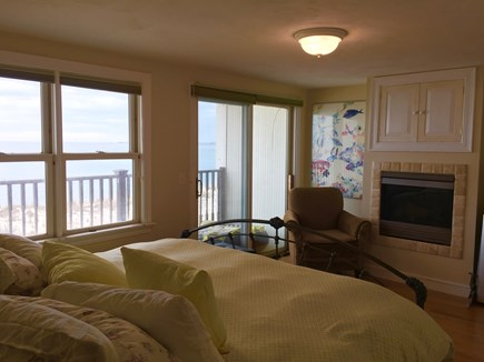 Truro Cape Cod vacation rental - Master with fireplace, TV above fireplace, slider to deck