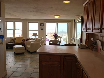 Truro Cape Cod vacation rental - Kitchen to dining with slider to the deck
