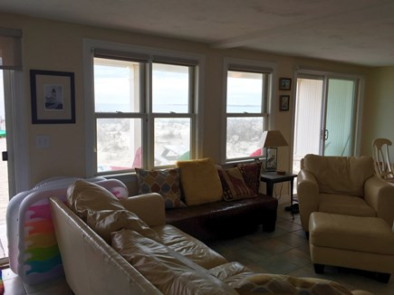 Truro Cape Cod vacation rental - Living room toward dining and out toward Provincetown