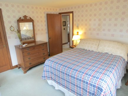 Brewster Cape Cod vacation rental - Master bedroom with a queen bed on main level.