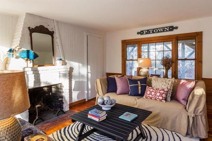 Wellfleet Cape Cod vacation rental - First floor living room with TV and half bath.