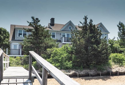 West Yarmouth Great Island Cape Cod vacation rental - Back of house, with walkway to private dock on Sweetheart Creek.