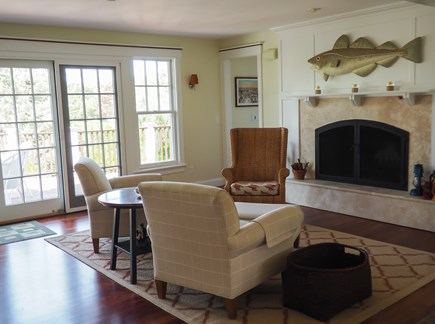 West Yarmouth Great Island Cape Cod vacation rental - Seating area in front of wood-burning fireplace. Doors to deck.
