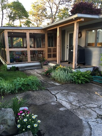 Chatham Cape Cod vacation rental - Kitchen garden entrance with screened porch overlooking pond