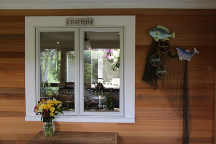 Chatham Cape Cod vacation rental - Screened in porch and view the  Atrium past the kitchen window