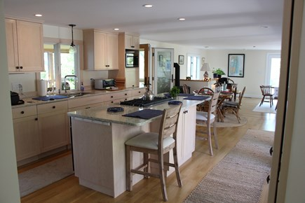 Chatham Cape Cod vacation rental - 36 in. Jenn-Air cooktop in island w/2 stools, visit with the chef