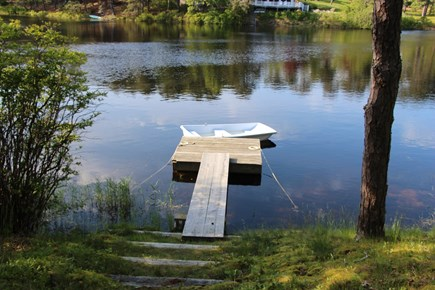 Chatham Cape Cod vacation rental - View of dock and rowboat from living room & pond side deck