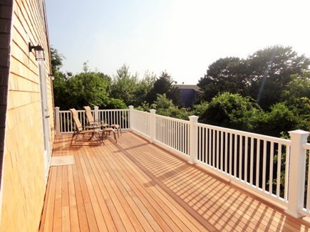 West Yarmouth Cape Cod vacation rental - beautiful 2nd floor deck off the master with peeks of the ocean