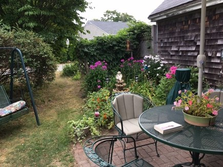 Falmouth Cape Cod vacation rental - Private patio with swing and gas grille and chiminea