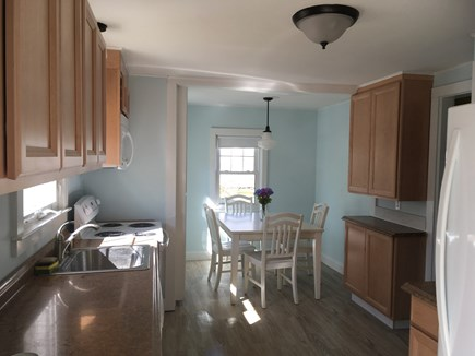 West Harwich Cape Cod vacation rental - Sunny eat in kitchen with modern appliances.