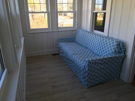 West Harwich Cape Cod vacation rental - Tranquil sun porch. Sit down and relax with a book...