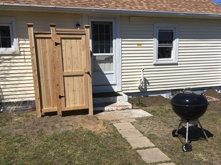 West Harwich Cape Cod vacation rental - Backyard with outdoor shower and grill!
