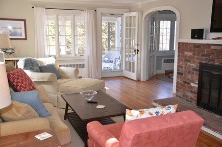 Brewster Cape Cod vacation rental - Living room opens to screened porch with view of marsh