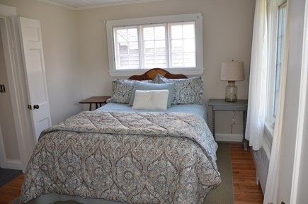 Brewster Cape Cod vacation rental - First floor bedroom with queen bed and adjacent half bath