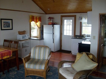 Yarmouth, The tip of South Sea Village Cape Cod vacation rental - Cathedral ceiling in the living/dining/kitchen area.