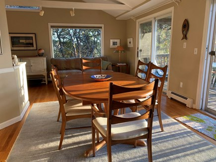 Wellfleet Cape Cod vacation rental - Open dining area looking toward trees and part of living area