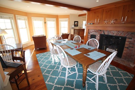 Harwich Cape Cod vacation rental - Dining area with water view flows into open kitchen.